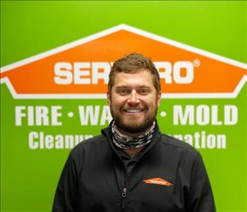 Man in front of SERVPRO logo